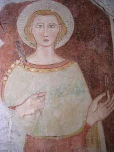 affresco votivo in cui il martine Claudio regge uno scalpello ed un martello