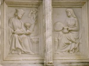 I due coniugi accanto al focolare domestico nel mese di Gennaio. Fontana maggiore di Perugia