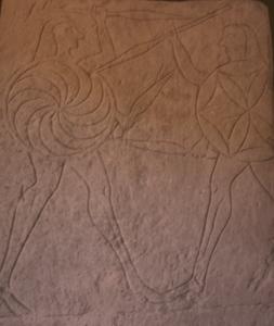 duello tra due principi etruschi: sullo scudo di destra è raffigurato il fiore della vita. VI-V secolo a.C.