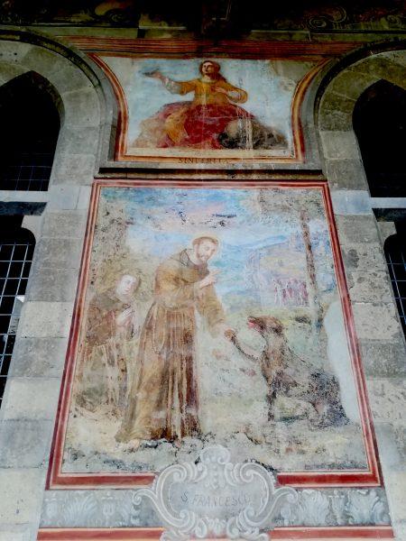 Francesco e il lupo. Affresco seicentesco dal chiostro del monastero di santa Chiara a Napoli